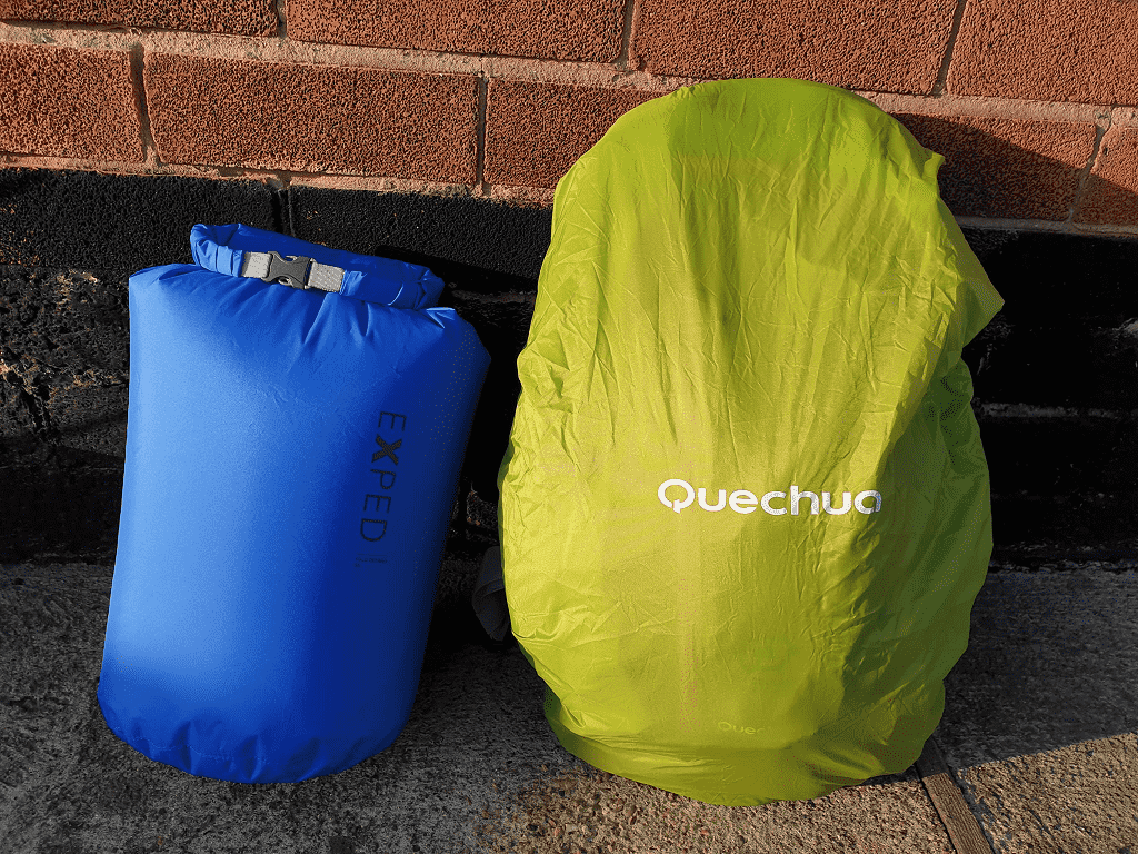 blue dry bag and green rain cover