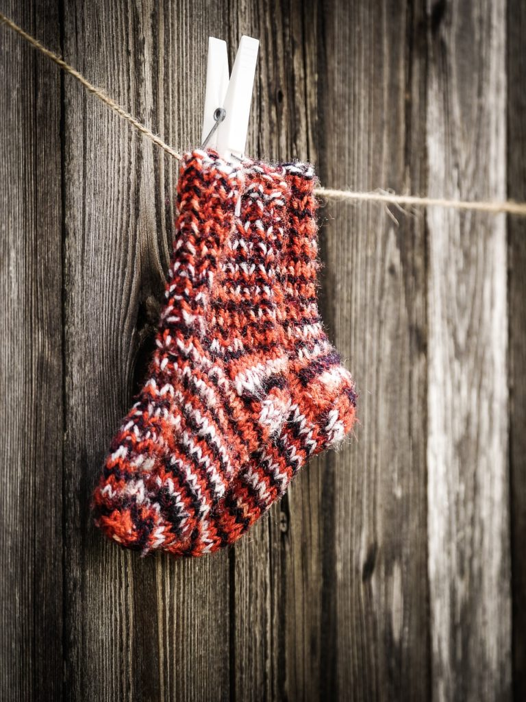 hand made socks hanging on a string