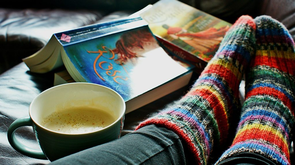 book, coffe and rainbow socks